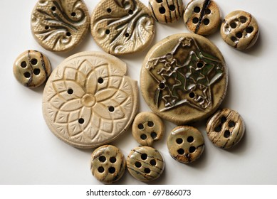 Ceramic buttons glazed with green seaweed