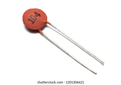 Ceramic capacitor used in electronic (104 generic capacitor) on white background