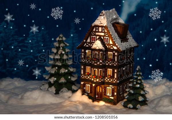 Ceramic Christmas Tree With Snow.Ceramic Christmas House Christmas Trees Under Stock Photo