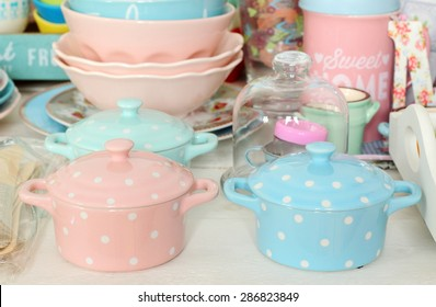 Ceramic cocottes and dishware in pastel colors