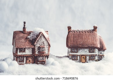Ceramic cottages in snow scene for Christmas