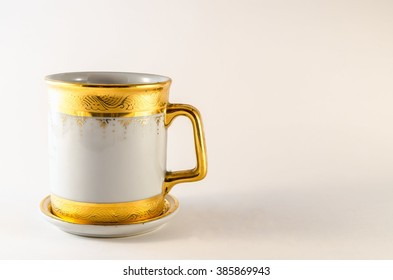 Ceramic cup closeup on white background