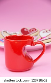 Ceramic cup with heart and cookies