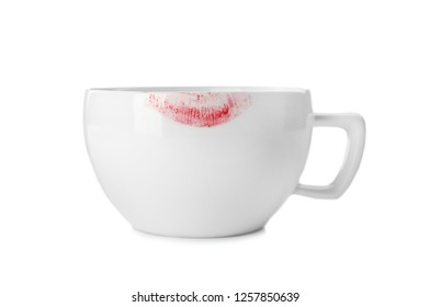 Ceramic cup with lipstick mark on white background