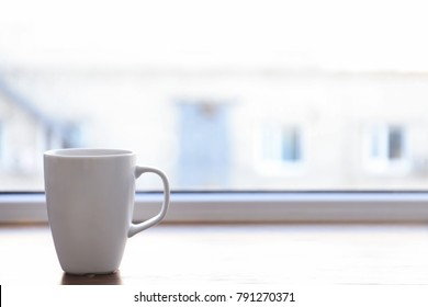 Ceramic cup on window sill