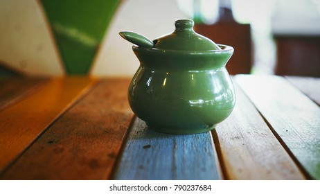 Ceramic cup on wooden table