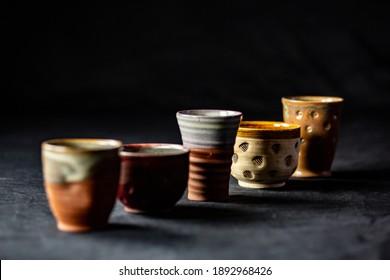 Ceramic cups in backlight in a dark environment
