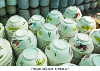 ceramic cups in a basket