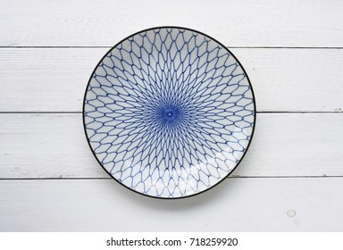 ceramic dish (plate) on wooden table.Flat lay