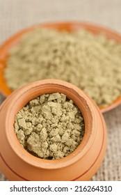 ceramic dishes filled with raw organic hemp protein powder