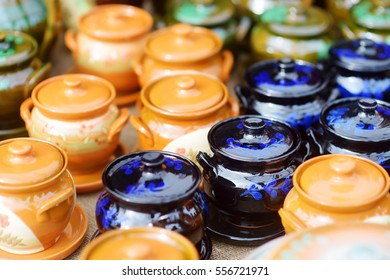 Ceramic dishes, tableware and jugs sold on Easter market in Vilnius. Lithuanian capital's annual traditional crafts fair is held every March on Old Town streets.