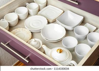 Ceramic dishware in kitchen drawer