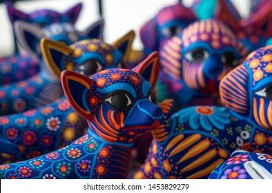 ceramic figures jaguars colorful pattern hand painted decoratives mexico artisans culture background
