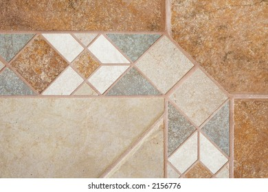 Ceramic floor tile border and field