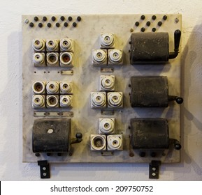 Ceramic fuses and knife switches on a wall