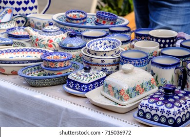 ceramic handmade dishes and plates with blue colored ornament on a table