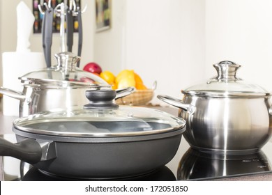 ceramic hob with pans in the kitchen