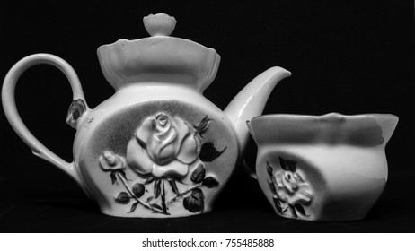 Ceramic kettle and cup for tea, tea ceremony on black background