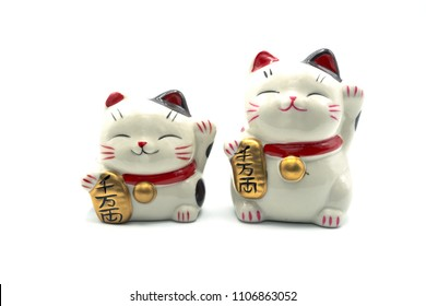 ceramic lucky cat statue for Japanese isolated on a white background, Holds a gold medal in Japanese that translates into prosperity and good fortune.