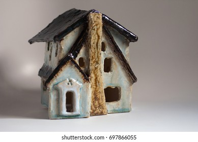 Ceramic miniature of my sister's Tudor revival house with chimney in front