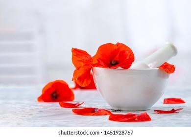 ceramic, mortar alternative medicine poppies flowers leaves vintage background