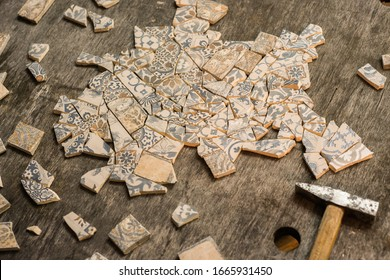 Ceramic mosaic making process. Do it yourself concept. Broken tiles and tools in workshop art studio.