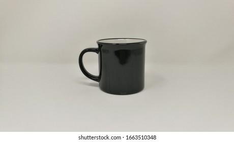CERAMIC MUG BLACK ON WHITE BACKGROUND