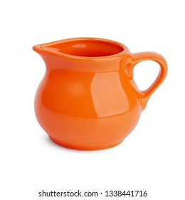 Ceramic orange jug of milk on white background