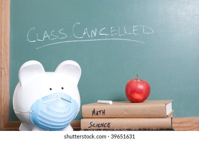 Ceramic pig with surgical mask sits with books and an apple in front of a chalkboard