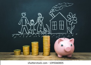 Ceramic piggy bank with gold money and Child's drawing - family near home