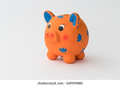 Ceramic piggy bank on white background / Piggy bank, close-up