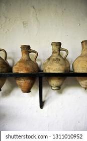 "Ceramic pitchers for the transfer of wine in a cellar of the famous ""manzanilla"" wine, Sanlucar de Barrameda, province of Cádiz, Spain."