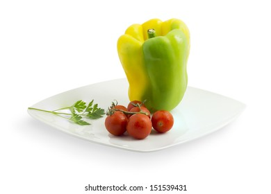 Ceramic plate with pepper, tomato and parsley