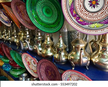 Ceramic plates and metal tea pots for sale in Moroccan souk