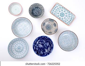 Ceramic plates on white background