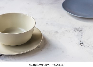 Ceramic plates on a white background close up.
