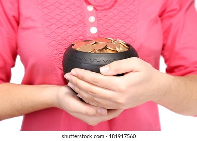 Ceramic pot with golden coins in female hands, isolated on white background