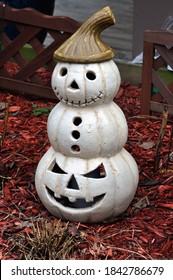 A Ceramic Pumpkin Snowman with a Brown Cap.