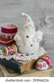 ceramic Santa Claus, Christmas decoration, vintage style and paper molds for baking cakes