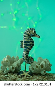 A ceramic seahorse in a light background
