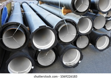Ceramic sewer pipe stacked on construction site