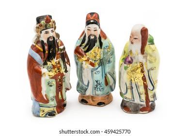 Ceramic Statue of Chinese Gods isolated on white background; God of Fortune (Fu,Hok), God of Prosperity (Lu,Lok), and God of Longevity (Shou,Siu)