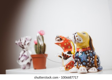 ceramic statuette of two dogs on a white background. Two dog statues for distinctive decoration on white background. vintage photo processing