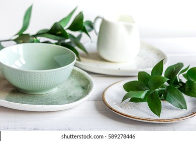 ceramic tableware with flowers on white background