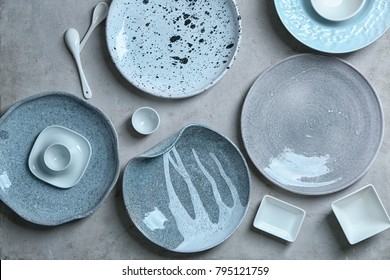 Ceramic tableware on grey background
