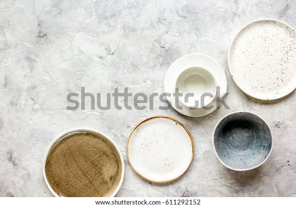 ceramic tableware top view on stone background mock up