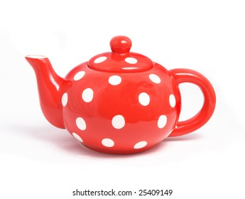 Ceramic teapot of red color on a light background.