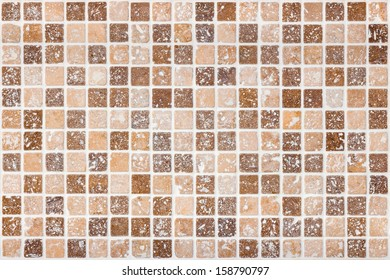 Ceramic tile background. Brown and beige square tiles.