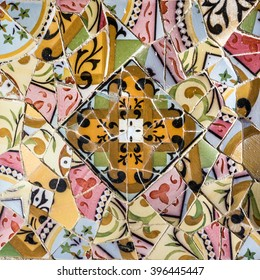 ceramic tile, broken glass mosaic, decoration in Park Guell, Barcelona, Spain. Designed by Gaudi