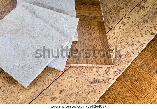 ceramic tile, cork and parquet wooden flooring samples for home interior remodel